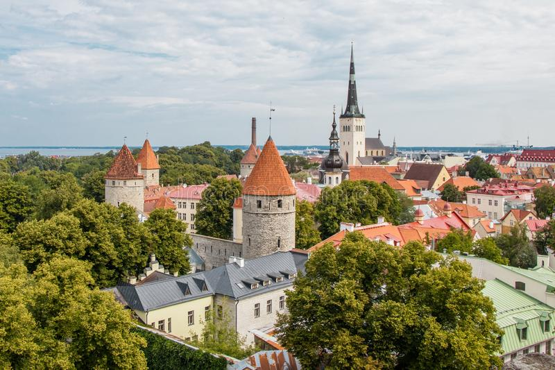 The orange roofs and spiers of the old city. Tallinn, Estonia. Top view on the orange roofs and spiers of the old city. Tallinn, Estonia, town, white, wall stock photos