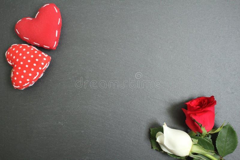 Orange rose flower on black slate background royalty free stock photography