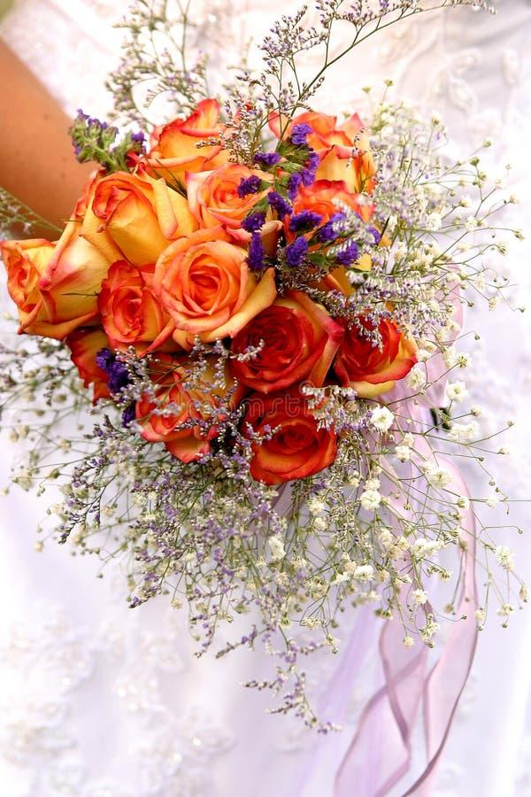 Orange roses wedding bouquet royalty free stock images
