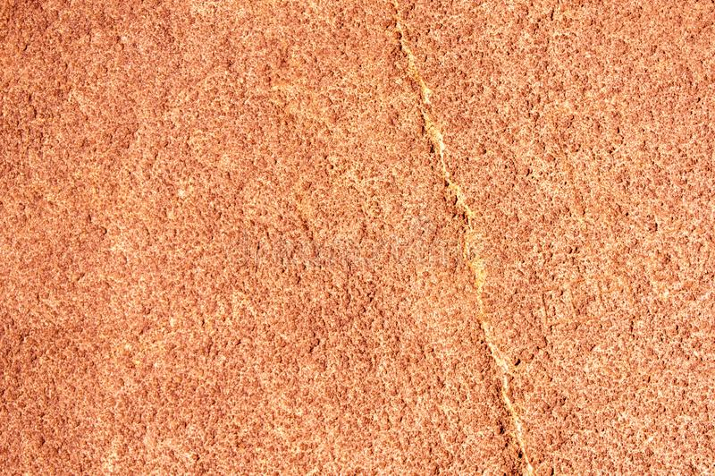 Orange rough stone texture closeup background. Copy space background royalty free stock images