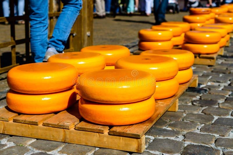 Orange, round Gouda soft delicious German cheese stock images