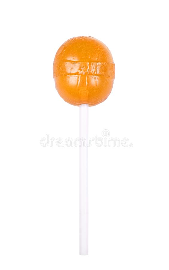 Orange round lollipop isolated on white. Sweet sugar candy. On a stick stock images
