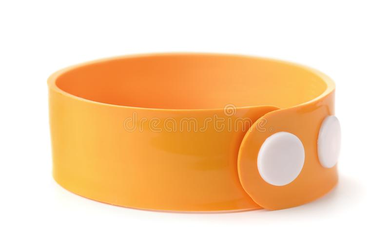 Orange rubber wristband stock image