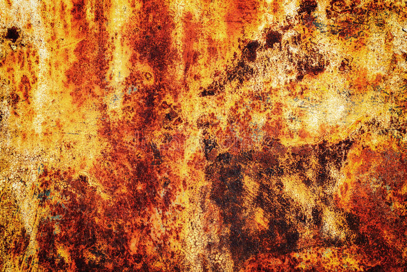 Orange Rust on Metal Surface Texture. Bright orange rust on a metallic surface with peeling specks of flaking metal stock photography