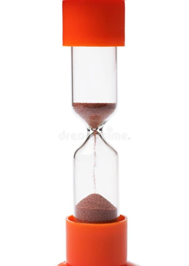 Orange Sanduhr lokalisiert auf weißem Hintergrund lizenzfreie stockfotos
