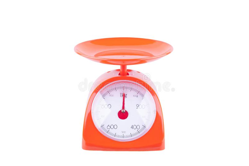 Orange scales weighing products on white background kitchen equipment object isolated royalty free stock photos