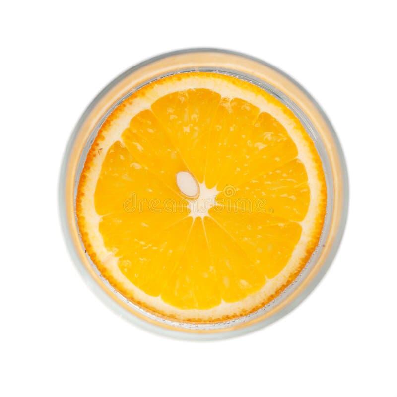Orange Scheibe in einem Glas, Draufsicht, stockbild