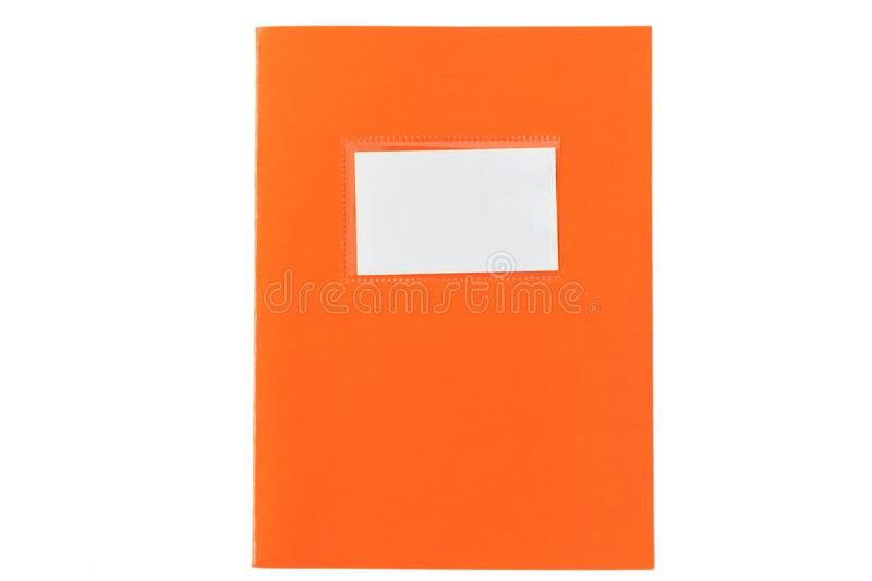 School notebook old fashioned isolated on white background, blank label, copy space, top view. Orange school notebook or diary, old fashioned, isolated on white stock image