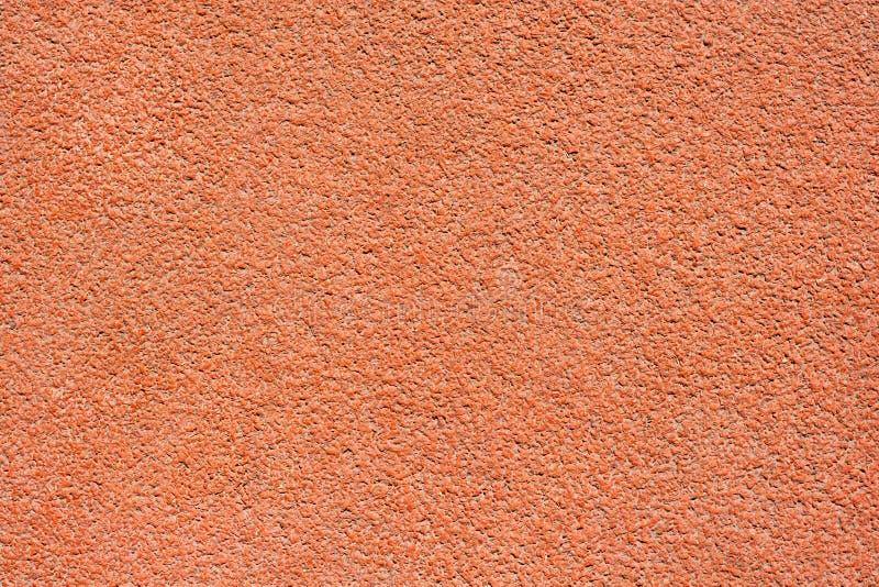 Orange Schottenstoffoberfläche einer Laufbahn lizenzfreie stockfotografie