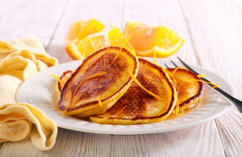 Orange scotch pancakes served on plate royalty free stock photos