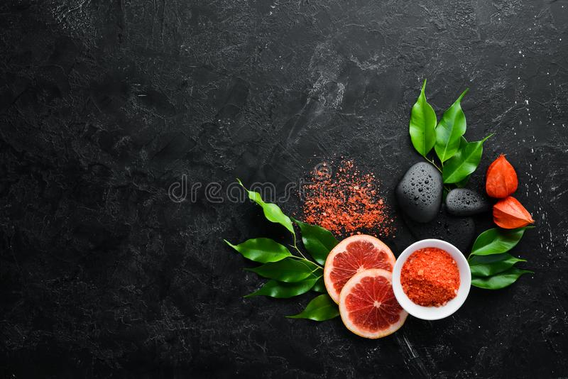 Orange sea salt with aroma of grapefruit. Spa treatments. Top view. Free copy space royalty free stock photo
