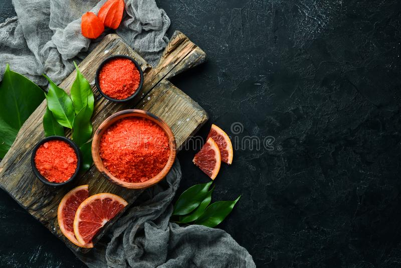 Orange sea salt with aroma of grapefruit. Spa treatments. Top view. royalty free stock images