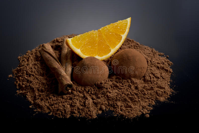 Orange segment with cocoa and cinnamon stock photography