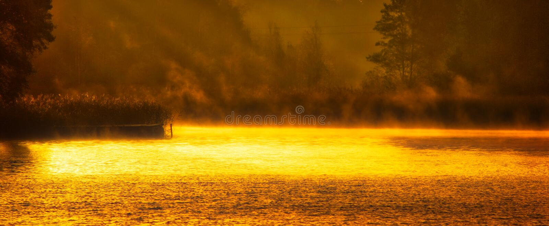 Shining water in lake at sunrise royalty free stock photo