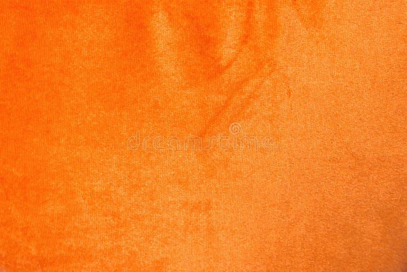 Orange shiny velvet texture background stock image