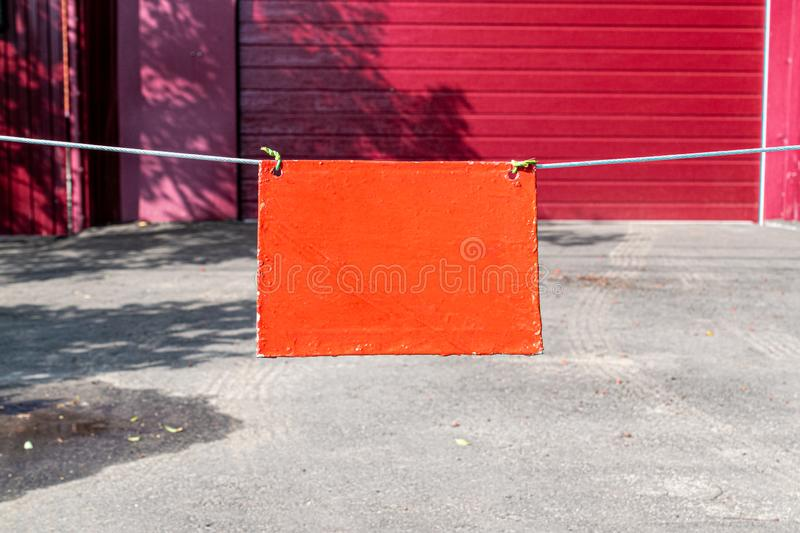 The orange sign on the claret background of the fence. Space for lettering or design.  royalty free stock photos