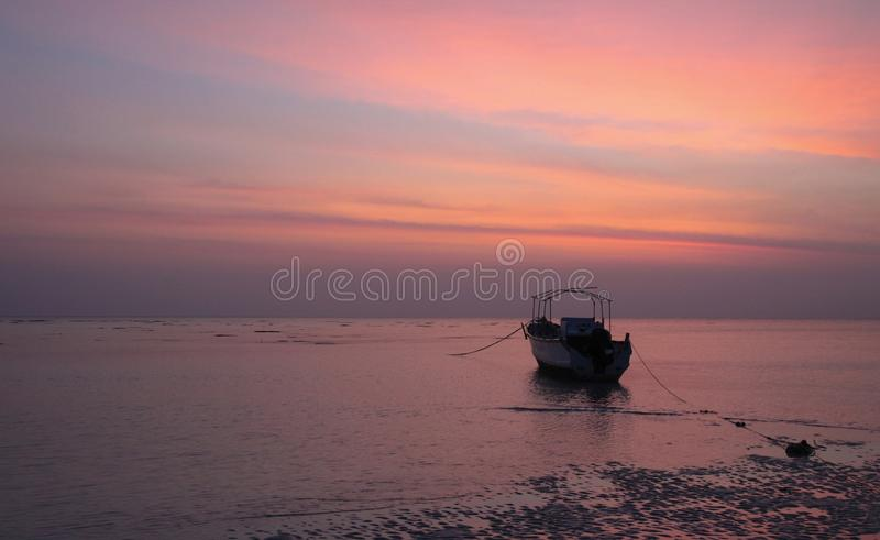 Download Orange Skies Grey Seas And A Lone Boat Stock Image - Image: 40568279