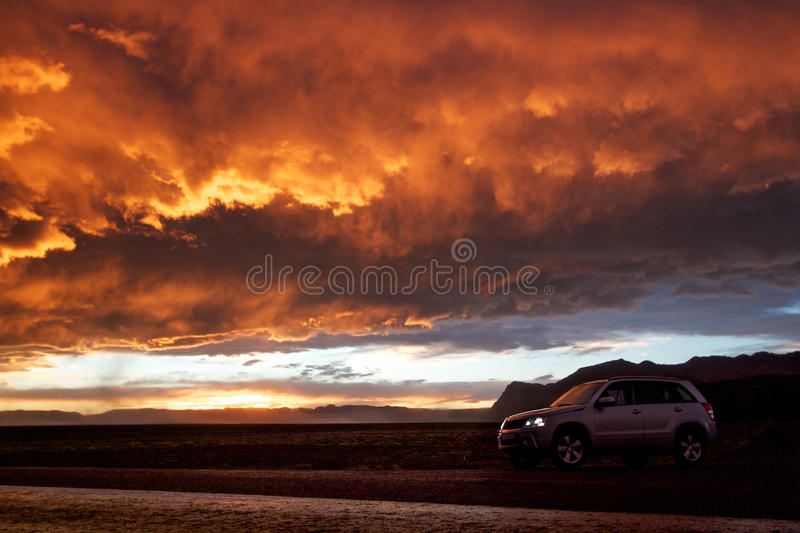 Orange sky and 4x4. Amazing sunset at Skaftafell in south east Iceland. A 4x4 is parked for the view royalty free stock photography