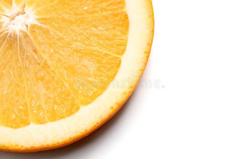 Orange slice. A juicy orange slice isolated on white royalty free stock photo