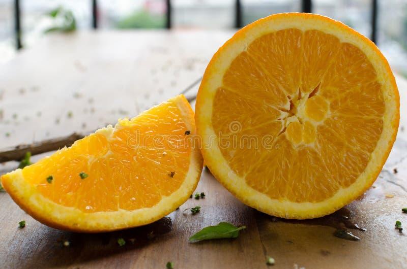 Orange and slice. Brazilian ingredients in wood table stock image
