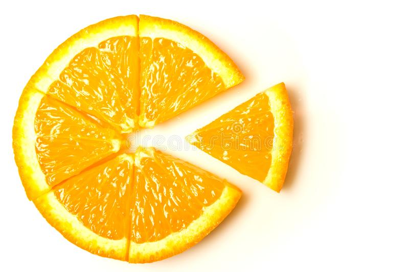 Orange slice cut into sectors, parts - a symbol, abstraction isolate. On a white background stock image