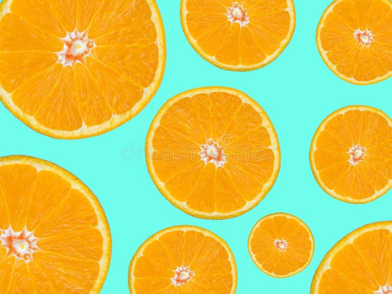 Orange slice for food and beverage background. orange slices. Textured surface pattern on green background, pop art style stock photo