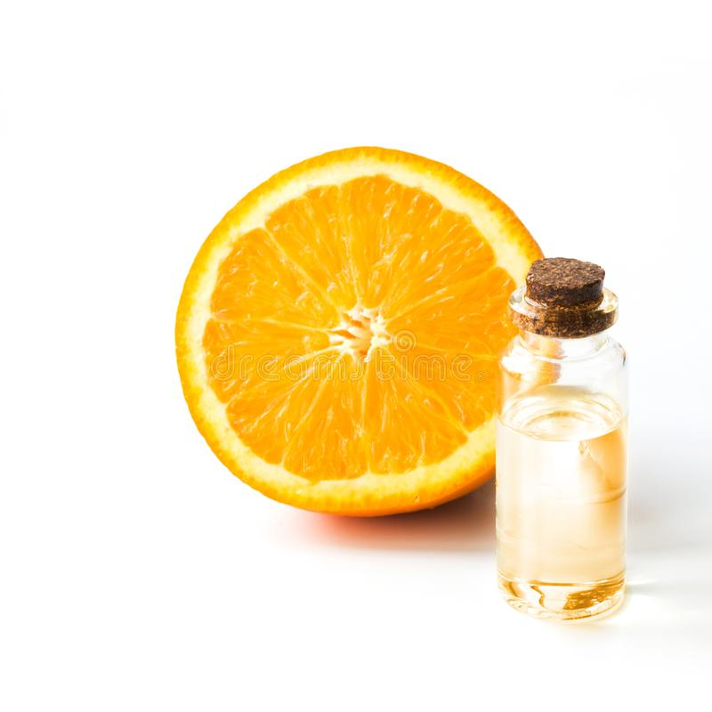 Orange slice fruit and bottle with oil or essence. Round slice isolated on white. Close up. Orange slice fruit and bottle with oil or essence. Round sliced stock photos