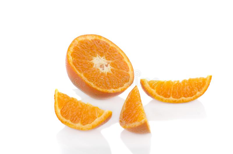 Orange slice isolate on white background. Fruit orange slice to four peace  on white background royalty free stock image