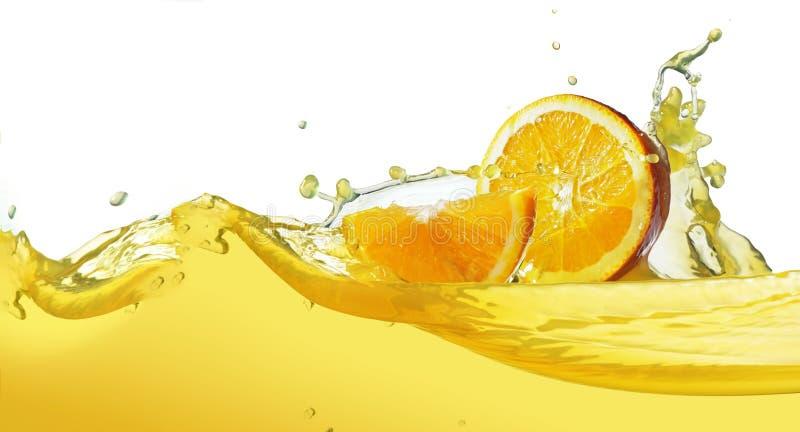Orange slice in juice stream royalty free stock image