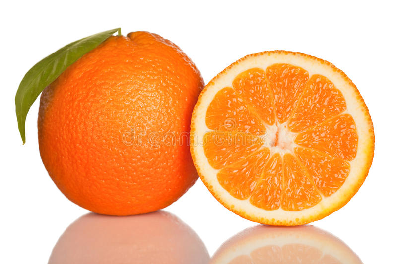 Orange and slice of orange on white stock images