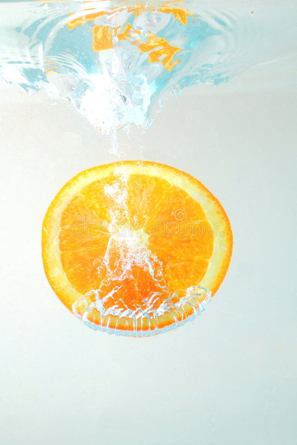 Orange slice in water royalty free stock images