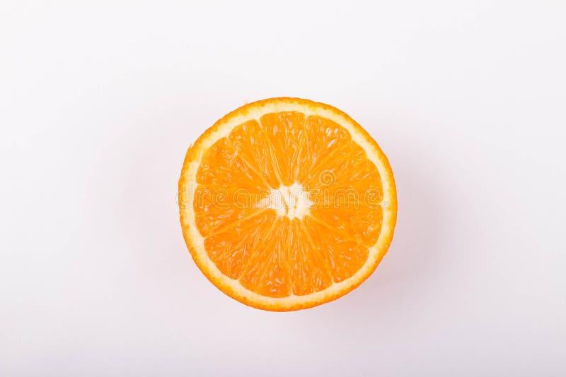 Orange slice on white background. Fresh orange slice on white background beautiful citron citrus clipping path closeup color cut cutout dessert diet eating stock photo