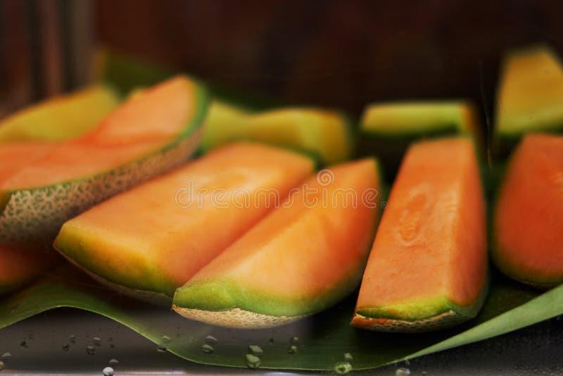 Orange sliced melon or Thai melon in natural banana leaf serve,closed up stock photos