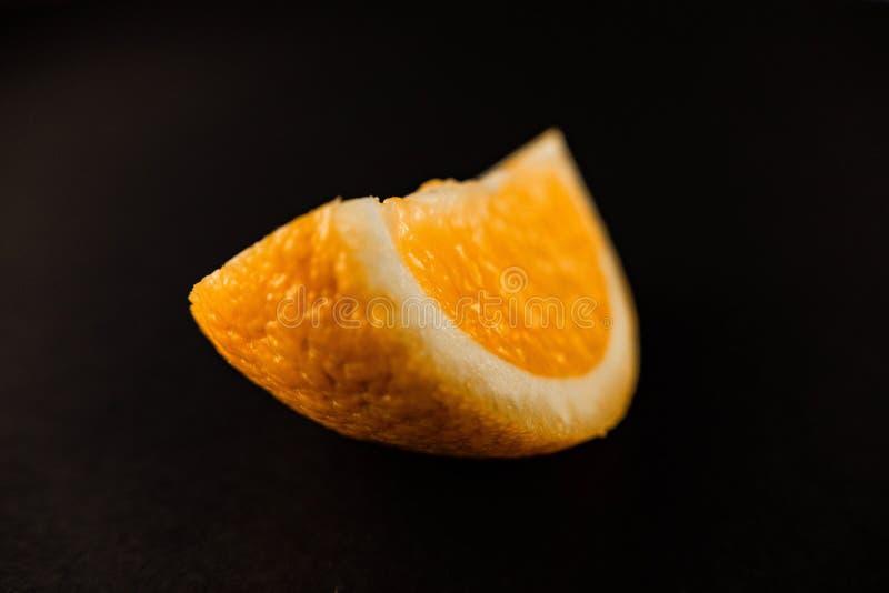 orange slices lying on a black background royalty free stock image