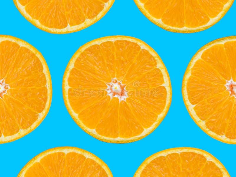 Orange slices pattern on blue background, pop art style.  royalty free stock images