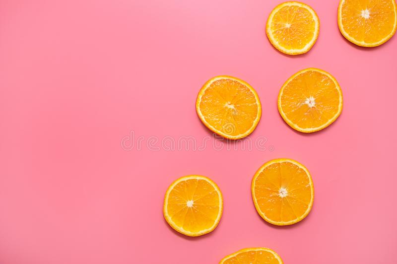 Orange slices on a pink background. fresh orange slices fruit pattern on pink background royalty free stock photography