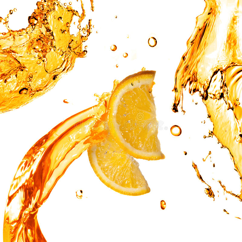 Orange slices and splashes of juice isolated on white royalty free stock images