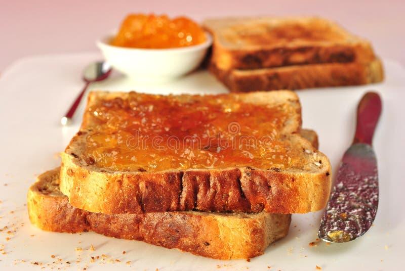 orange smörgås för marmelade royaltyfria foton