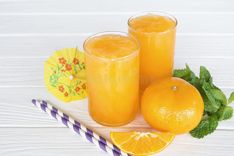 Orange smoothies fruit on old white wood background. Orange smoothies orange colorful fruit juice beverage healthy high protein the taste yummy in glass on royalty free stock image