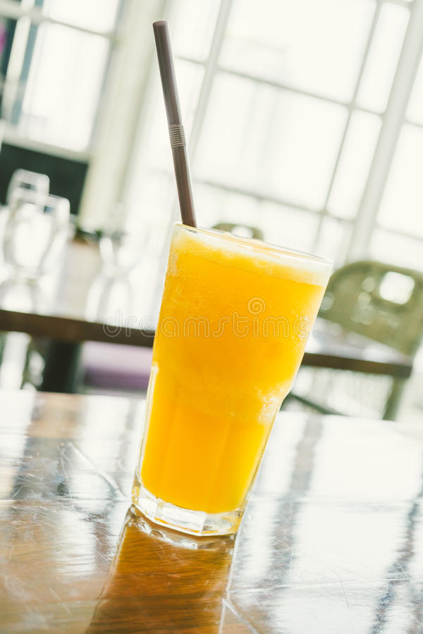 Orange smoothies. Iced orange juice smoothies glass on table - Color Filter Processing stock images