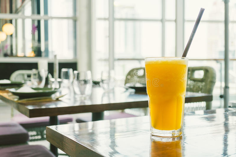 Orange smoothies. Iced orange juice smoothies glass on table - Color Filter Processing stock photo