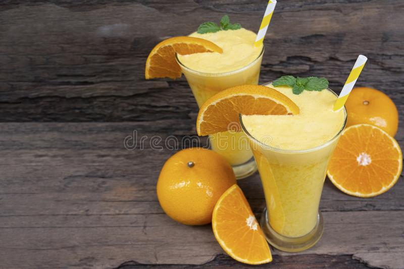 Orange smoothies orange colorful fruit juice beverage healthy high protein . Orange smoothies orange colorful fruit juice beverage healthy high protein the royalty free stock photography