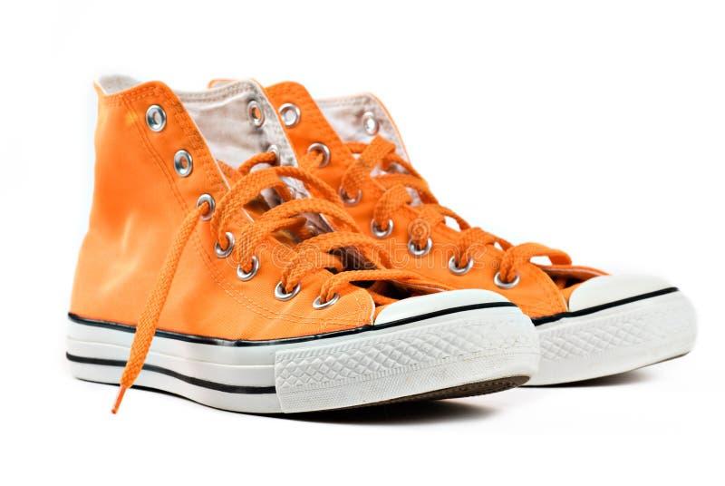 Orange sneakers isolated stock photo