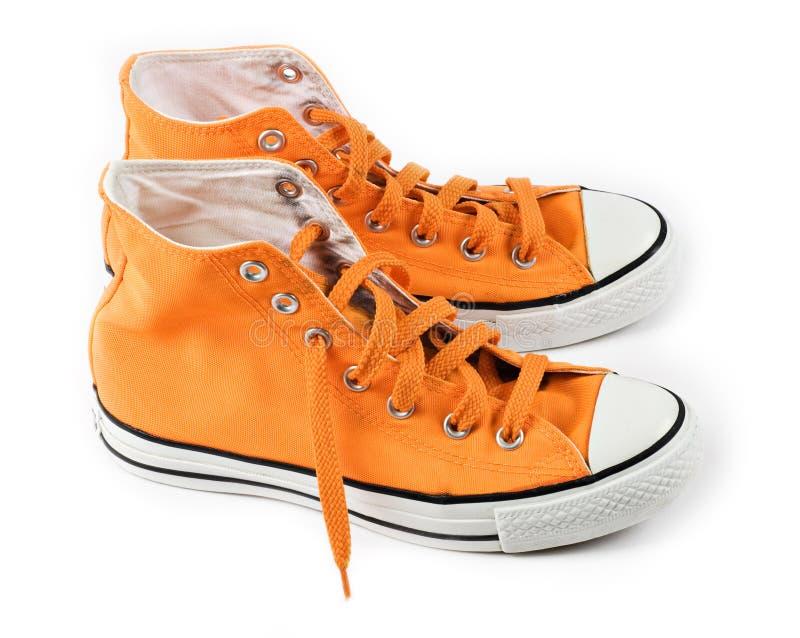 Orange sneakers isolated stock image