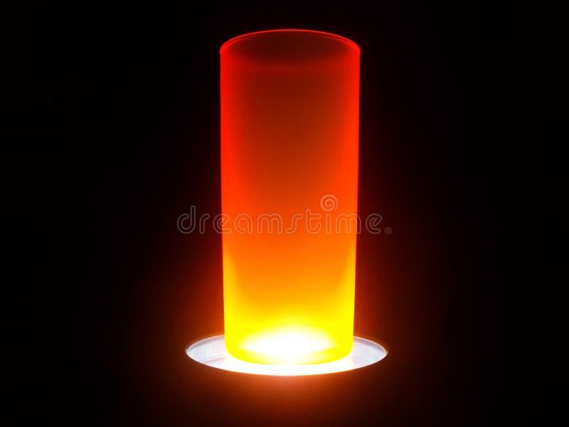 Orange snowed vase illuminated stock photography