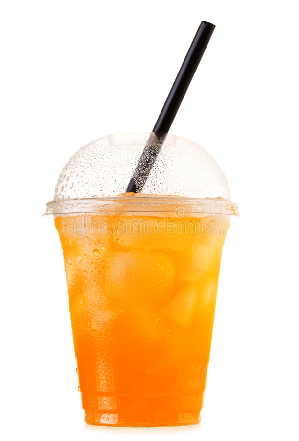 Orange soda with ice in takeaway cup isolated on white background. Cold orange soda with ice and straw in takeaway plastic cup isolated on white background royalty free stock images