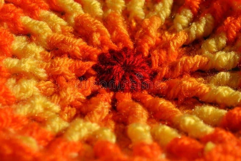 Orange sol texturerad tygbakgrund fotografering för bildbyråer