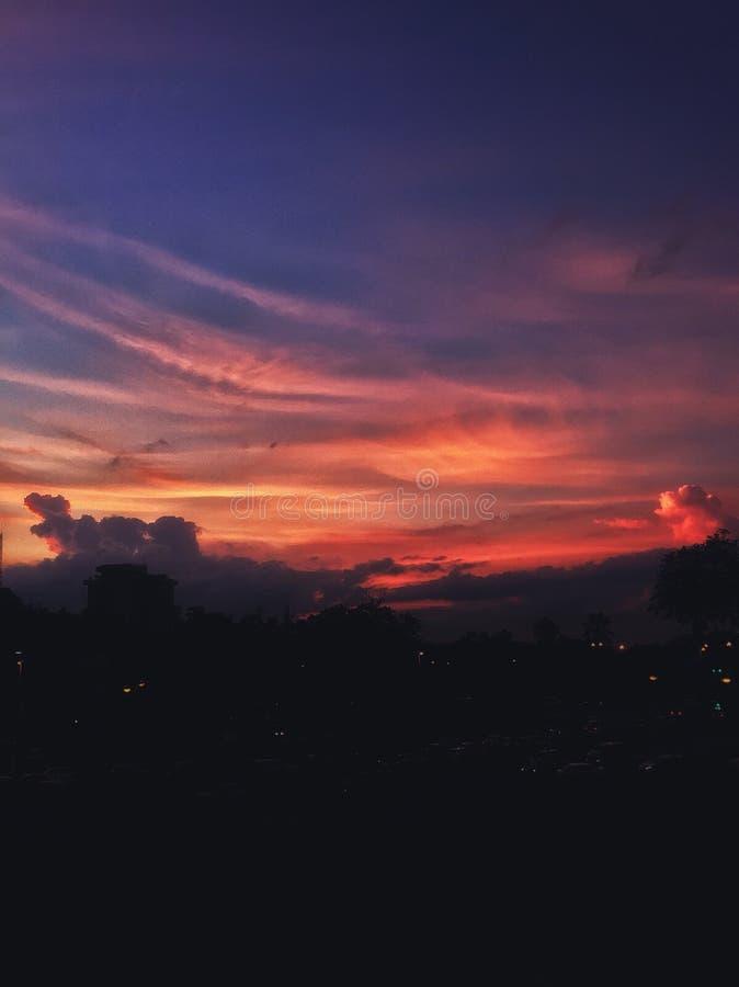 Orange Sonnenuntergänge stockfotografie