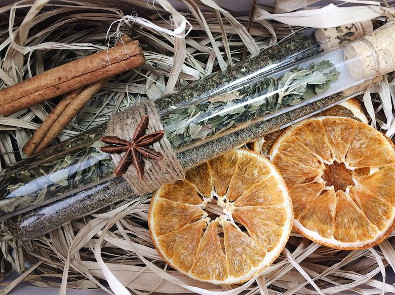 Orange and spices on straw stock image