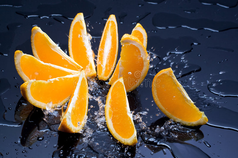 Orange in splash stock photo